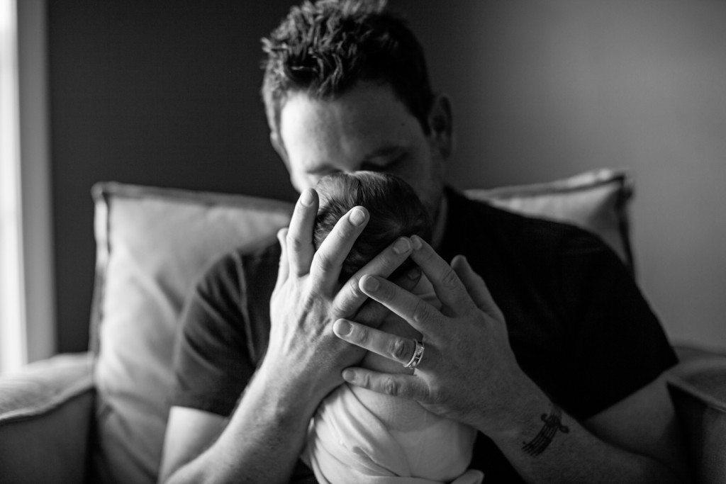 newborn hands dad